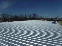 After a completed commercial roofing company project in the area