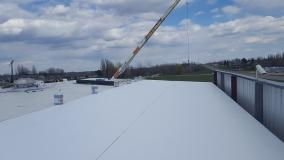 Before a completed commercial roofing company project in the area