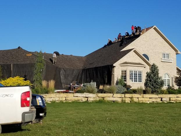 Before a completed tile roofing company project in the area